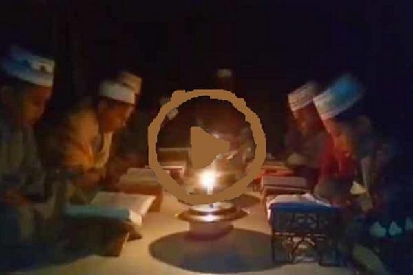 কুপির আলোতে এতিম শিশুদের কোরআন তিলাওয়াত