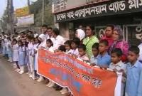 চাঁপাইনবাবগঞ্জে নারী ও শিশু নির্যাতন প্রতিরোধে মানববন্ধন