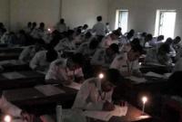 ঝড়ে-বিদ্যুৎ-বিভ্রাট-মোমবাতি-জ্বালিয়ে-পরীক্ষা-দিচ্ছেন-শিক্ষার্থীরা